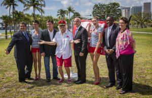 Richard Branson next to Miami Mayor with his tie at the Virgin Cruises announcement.