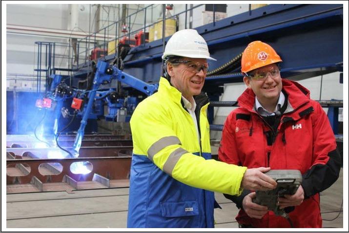 Hurtigruten CEO Daniel Skjeldam (right) cuts steel on the hybrid expedition ship MS Roald Amundsen