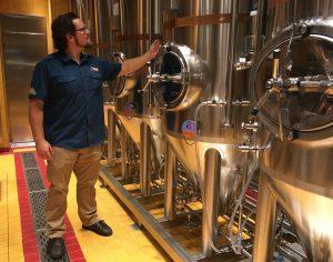 Colin Presby checks his brewing equipment on Carnival Vista