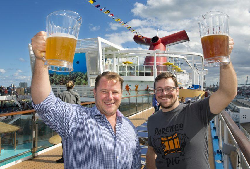 President of Beverage Operations Edward Allen, left, and Brewmaster Colin Presby, right, hoist pitchers filled with craft beers. Photo: Andy Newman/Carnival Cruise