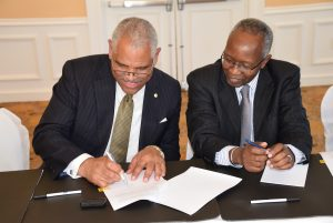Carnival Corporation President Arnold Donald and Prime Minister the Right Honourable Perry G. Christie sign the agreement