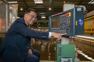Genting CEO Tan Sri Lim Kok Thay presses the button.