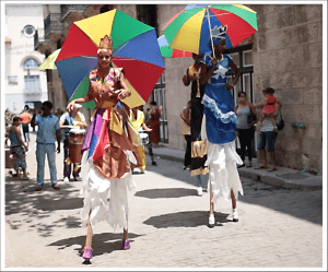 Street performers entertain visitors to Cuba