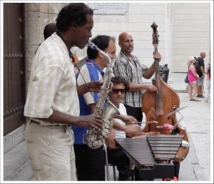 Musicians play in a Shoreside Scene from Cuba