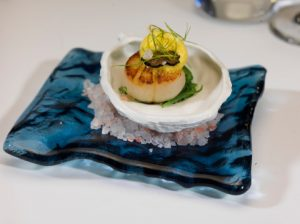 A seared scallop amuse-bouche