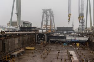 The coin block is moved to MSC Seaview's hull in drydock.
