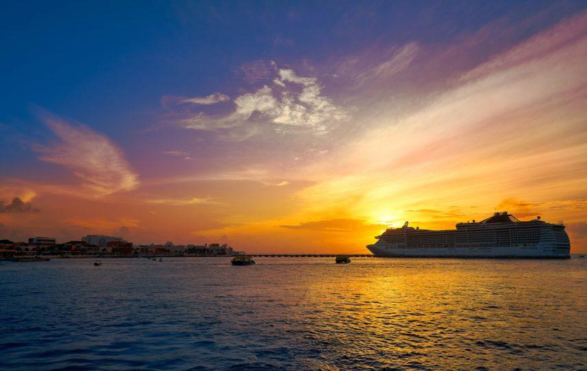Cruise ship off Cozumel at sunset, cruising the Riviera Maya, Mexico. Photo: Ingram Image
