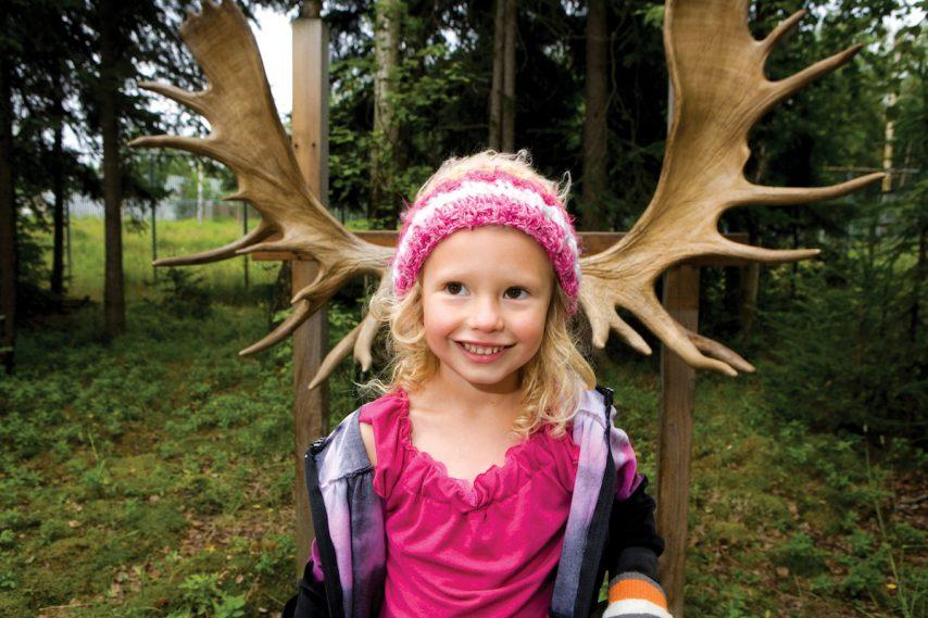 Kids and moose antlers in Anchorage Alaska