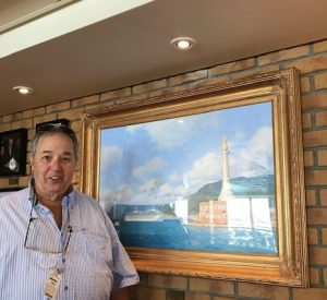 Stephen Card in front of his portrait of Carnival Triumph entering Messina, which it never really did but we won't tell.